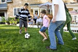 Family Playing In Yard Marietta