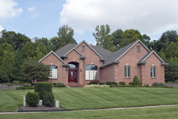 Brick Home With Green Lawn